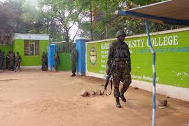 Kenyan Defence soldier walks past Garissa University Credit: Mirror.co.uk