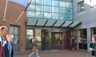 'The New DCU' sign outside the Hub