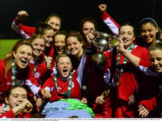 Shelbourne captain Carroll, seated, celebrates with her team mates. Credit: Sportsfile.