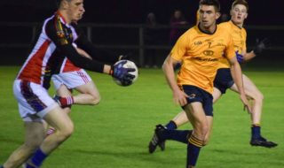 DCU's Colm Begley has eyes only for the ball. Credit: Chaitanya Brady