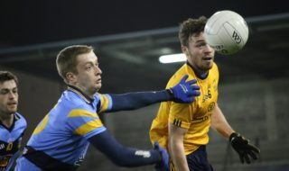 DCU's Conor Moynagh has his eyes on the ball during the Ryan Cup Final.