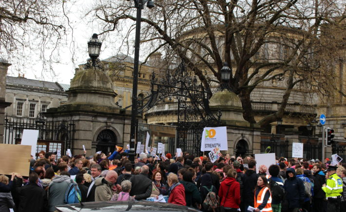 Around 200 people gathered outside Dáil Éireann on Thursday to protest against the recent €12 million cuts to metal health resources.