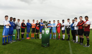 Players from all CUFL Division One teams line up with the league trophy. Credit: FAI