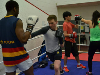 DCU teammates spar together in training. Credit: Laura Horan