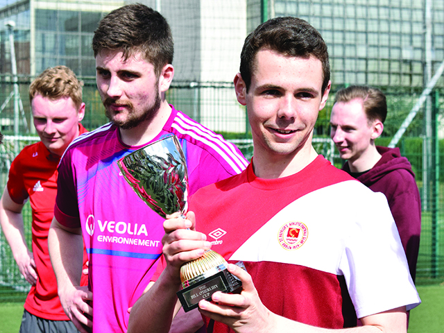 Aaron Gallagher of The College View proudly holds the Bill O'Herlihy Cup after beating DCUfm. Credit: Sarah O'Neill.