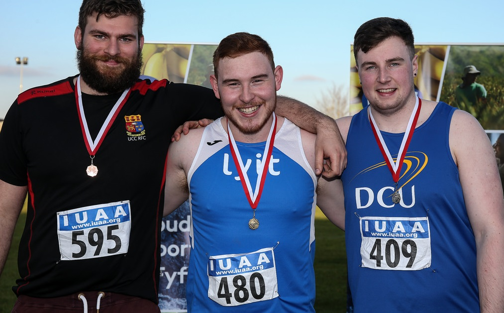 DCU's Eoin Sheridan celebrates his silver medal in the shot put. Credit: Enda Fitzpatrick.