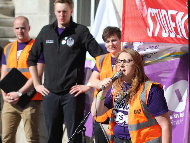USI VP for Equality and Citizenship Síona Cahill addresses Students for Choice protestors in the front square of TCD. Image Credit: Mark Carroll