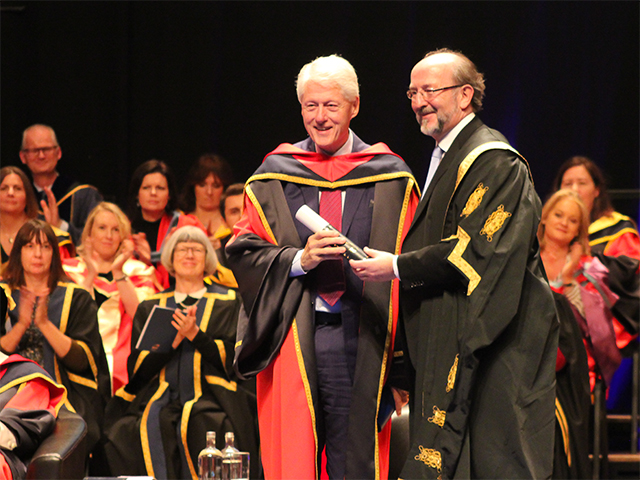 Bill Clinton receives his honorary doctorate from DCU President Brian MacCraith. Credit: Fionnuala Walsh