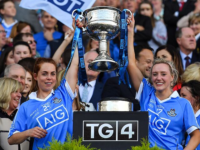 Fiona Hudson, right, lifts the Brendan Martin Cup with Sinéad O'Mahony after Dublin's final victory over Mayo. Image credit: Brendan Martin/Sportsfile