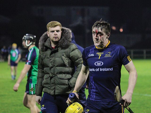 DCU's Daire Grey after a heavy hit. Image Credit: Mark Carroll